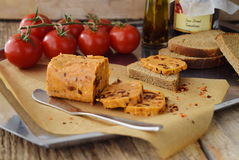 Homemade butter with sun-dried tomatoes for spreads on a baking paper. Healthy food concept. Stock Photography