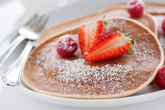 Homemade buttermilk american pancakes with fresh strawberry and raspberry on a white plate Royalty Free Stock Photos