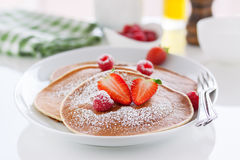Homemade buttermilk american pancakes with fresh strawberry and raspberry on a white plate Royalty Free Stock Image