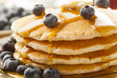Homemade Buttermilk Pancakes with Blueberries and Syrup Royalty Free Stock Photos