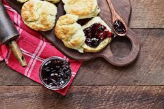Homemade Buttermilk Southern Biscuits with Berry Preserves. Buttermilk southern biscuits or scones served with homemade fruit preserves. Top view stock images