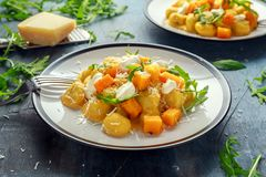 Homemade Butternut squash gnocchi with wild rocket and parmesan, ricotta cheese.  Royalty Free Stock Photos