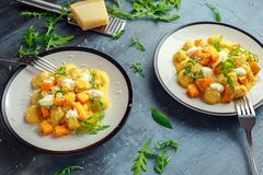 Homemade Butternut squash gnocchi with wild rocket and parmesan, ricotta cheese.  Stock Image