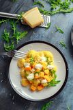 Homemade Butternut squash gnocchi with wild rocket and parmesan, ricotta cheese.  Royalty Free Stock Photography