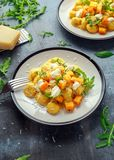 Homemade Butternut squash gnocchi with wild rocket and parmesan, ricotta cheese.  Royalty Free Stock Images
