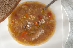 Homemade Cabbage soup, pork ribs. Wholemeal bread stock photography
