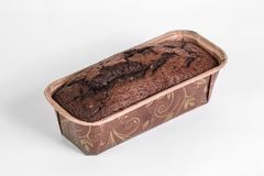 Homemade cacao bread in the baking paper mold Stock Photo