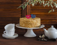Homemade cake on a ceramic stand for the cake, tea set, paper hearts, a flower. Valentine's day romantic Breakfast. Stock Photo