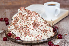 Homemade cake with cherries and sour cream. On the plate Royalty Free Stock Photos