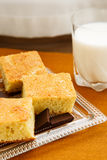 Homemade cake with chocolate and milk. Portions of homemade cake with chocolate and glass of milk for breakfast or snack Royalty Free Stock Photo