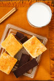 Homemade cake with chocolate and milk. Portions of homemade cake with chocolate and glass of milk for breakfast or snack Royalty Free Stock Photography