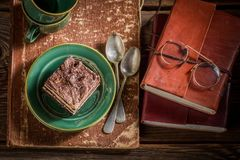 Homemade cake and coffee on desk writer Royalty Free Stock Images
