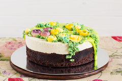 Homemade cake with colorful cream flowers Stock Photo