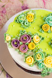 Homemade cake with colorful cream flowers Stock Photography
