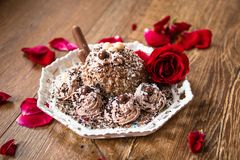 Homemade cake with cooked minced wheat and walnuts and rose flower stock image