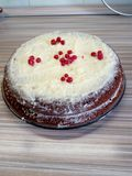 Homemade cake with cream and berries. In a transparent plate on the table royalty free stock photo