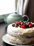 Homemade cake with cream, chocolate balls and cookies Royalty Free Stock Photo