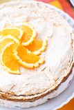 Homemade Cake with cream and oranges. On a multicolor blurred background royalty free stock photography