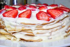 Homemade cake with cream and strawberry, close-up. stock image