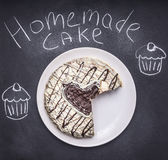 Homemade cake with a heart on the chalkboard, a pattern of cakes top view Stock Photography
