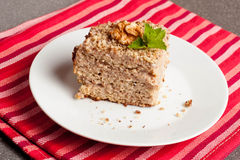 Homemade cake with honey, walnuts, cream and jam on wooden desk Stock Photography