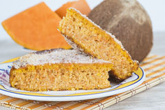 Homemade cake made of coconut and pumpkin Royalty Free Stock Images