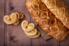 Homemade cake and pastries in the shape of a heart royalty free stock images