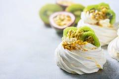 Homemade cake Pavlova with whipped cream, fresh kiwi and passion fruit. Stock Photos
