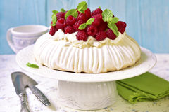 Homemade cake. Pavlova with whipped cream and fresh raspberry on a light background Stock Photo