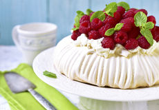 Homemade cake. Pavlova with whipped cream and fresh raspberry on a light background Royalty Free Stock Photography