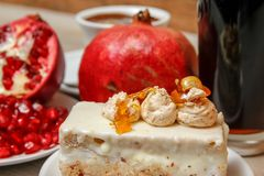 Homemade cake, pomegranate and coffee in a white cup royalty free stock images