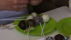 Homemade cake pops packed in gift boxes. Candy covered with black and white chocolate. Decorated with a different color dressing. Homemade cake pops packed in stock footage