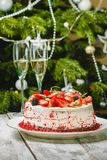 Homemade cake Red Velvet. Decorated with cream and berries over christmas background Royalty Free Stock Photo