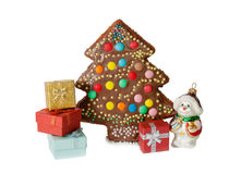 Homemade cake in shape of christmas tree, gift boxes Royalty Free Stock Photos