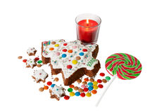 Homemade cake in  shape of  christmas tree , small biscuits, candle Royalty Free Stock Photography