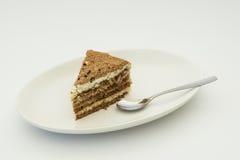 Homemade cake and spoon. Homemade cake on white plate and spoon Stock Photo