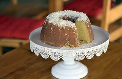 Homemade cake topped with coconut flakes stock photo
