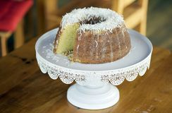 Homemade cake topped with coconut flakes stock image