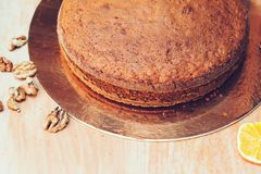 Homemade cake on wooden table, close up. Tasty traditional fruit cake with nuts. Healthy food. Homemade baking. Traditional cake r. Ecipe. Fresh bake pie. Copy royalty free stock photo