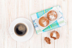 Homemade cakes and coffee cup. On white wooden table. Top view Royalty Free Stock Photography