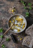 Homemade calendula, essential oil dead sea salt on wooden background stock images
