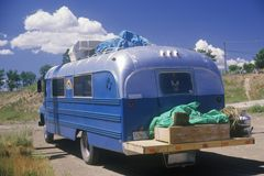 A homemade camper driving down the road to Taos, New Mexico Royalty Free Stock Images