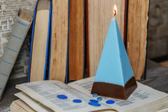 Homemade candle in the shape of a pyramid stock photos