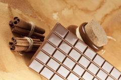 Homemade candy - chocolate, cocoa and cinnamon sticks Royalty Free Stock Images
