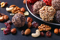 Homemade candy with chocolate , nuts and dried strawberry Stock Images