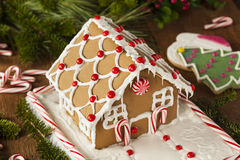 Homemade Candy Gingerbread House. With Candycanes and Frosting royalty free stock photos