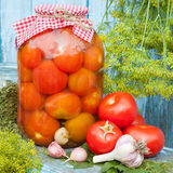 Homemade canned tomatoes in glass jar. Fresh vegetables, dill an Royalty Free Stock Photo