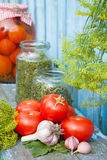 Homemade canned tomatoes in glass jar. Fresh vegetables Stock Photos