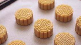 Homemade cantonese moon cake pastry on baking tray before baking for traditional festival. Homemade cantonese moon cake pastry on baking tray before baking for stock video