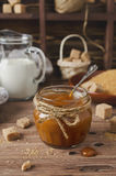 Homemade caramel sauce on wooden table Stock Photo